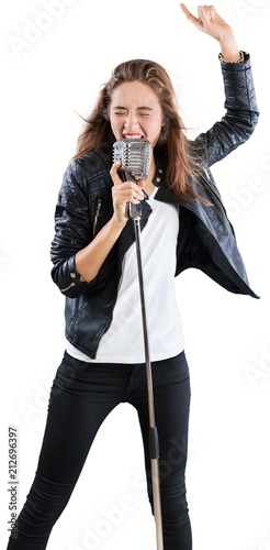 Fototapeta Female Rockstar Singing With Retro Vintage Microphone