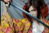 Cute asian girl with katana