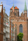 Mariacka street with colorful facades of tenement houses and St. Mary's Church, Gdansk, Poland