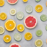 Flat lay summer background sliced citrus fruit light background