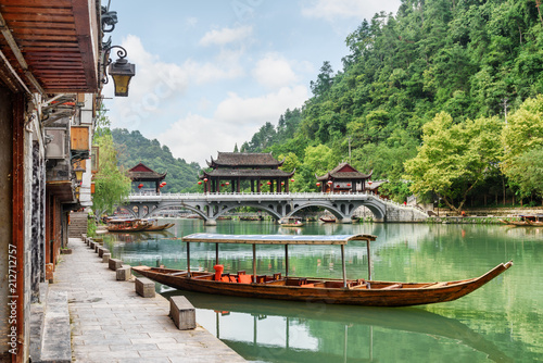 Parked wooden tourist boat on the Tuojiang River, Fenghuang - 212712757