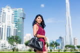 Tourist woman on city vacation in Dubai front of burj al khalifa