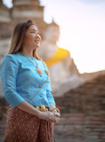 toothy smiling face of asian woman standing in ayuthaya world heritage site of unesco thailand
