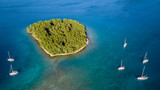 Aerial view of sailing boats anchoring next to small island - 212721969