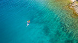 Aerial view of young man riding paddleboard - 212722307