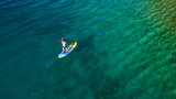Aerial view of young man riding paddleboard - 212722335