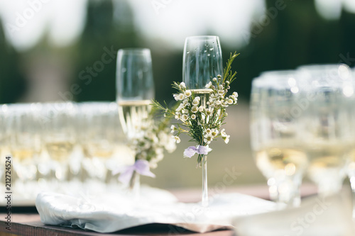Champagne glasses specially decorated to celebrate a wedding or luxury birthday garden party