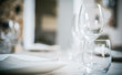 Glasses on a restaurant table. Very shallow depth of field