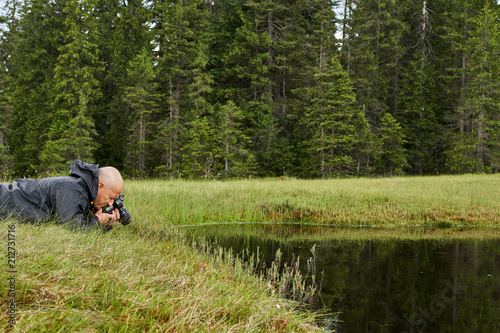 Photographer shooting a macro scene - 212731716