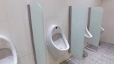Urinals and toilet cubicles. Dolly video - 212743346