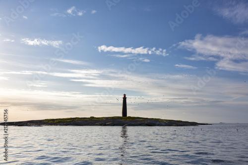 Fotobehang Vuurtoren Lighthouse on the island Top in the White Sea, Solovki, Russia