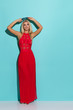 Beautiful Blond Woman In Red Dress Is Holding Sunglasses And Looking Away