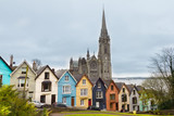 Cathedral  and colored houses in Cobh, Ireland - 212756578