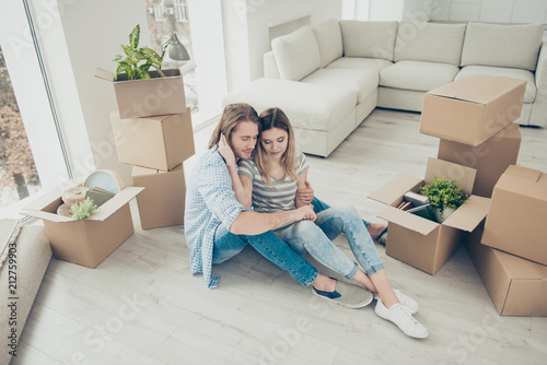Mortgage boyfriend girlfriend real estate decision concept. Top high angle view photo of calm with closed eyes beautiful pretty  lady hugging her man's neck leaning on his chest thinking about future