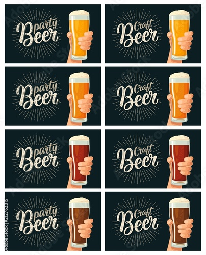 Fototapeta Male hand holding a glass with four types beer - light, white, red and dark