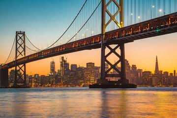 San Francisco skyline with Bay Bridge at sunset, California, USA