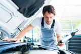 Auto mechanic working in car service workshop - 212769754