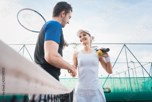 Fotobehang Tennis Man and woman shaking hands after match of tennis
