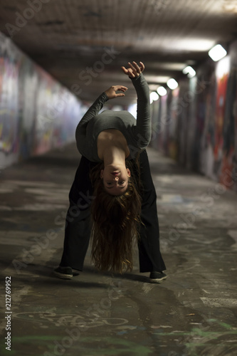 Fototapeta Female Dancer in Motion Dancing in an Urban Underpass