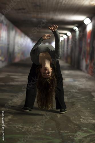 Female Dancer in Motion Dancing in an Urban Underpass