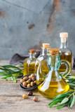 Assortment of fresh organic extra virgin olive oil in bottles - 212770310