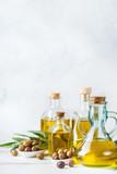 Assortment of fresh organic extra virgin olive oil in bottles - 212770341