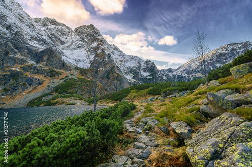 A hiking trail near the high mountain lake. - 212771740