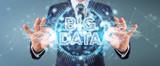 Businessman using Big Data digital hologram 3D rendering - 212775151