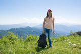 Child Girl In Mountains On Green Grass