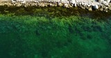 Aerial top view on clear green and blue water in adriatic sea. - 212784110