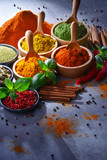Variety of spices on kitchen table - 212786152