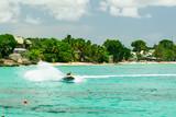 Jet ski rider on tropical pristine beach in Barbados - 212795321