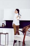 pretty stylish woman in fashion dress with leopard print in luxu - 212799726