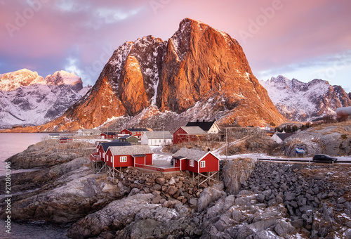 Leinwanddruck Bild Houses in the Lofoten islands bay. Natural landscape during sunrise