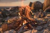 fire burns near the sea - 212804997