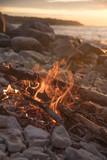 fire burns near the sea - 212805563