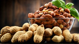 Bowl with peanuts on wooden table. - 212806709
