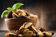 Bowl with Brazil nuts on wooden table - 212806950