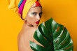 girl behind tropical leaf