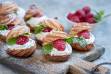 Raspberries Profiteroles with White Chocolate cream