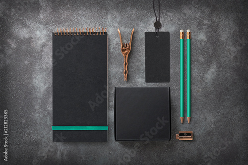 Leinwanddruck Bild dark elegant branding / identity mockup with blank notebook, black cardboard box for packaging purposes, tag with metal seal, copper utensils, turquoise details / accents - top view