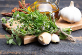 Aromatic fresh kitchen herbs, garlic, onion and olive oil, main ingredients for many dishes in medditerranean cuisine - 212824785
