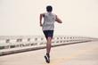 Black men runner are running on the bridge.black man doing workout outdoors,