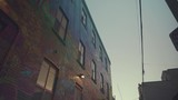 Low angle view tracking next a graffiti covered building in Graffiti Alley in Toronto - 212846743