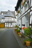 old small German town on the river bank narrow streets, pavement flowers on the windows - 212867774