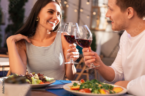 Nice earrings. Stylish woman wearing nice earrings drinking wine with her boyfriend - 212871113