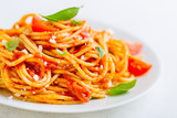 Pasta dish with tomato sauce on white plate - 212871350