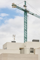 Modern building and crane machinery structure. Construction industry