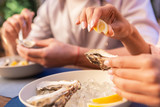 Restaurant of seafood. Young just married couple enjoying summer atmosphere while visiting restaurant of seafood - 212872984