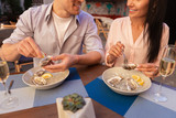 Romantic date. Young cute couple having amazing romantic date while spending evening in seafood restaurant - 212873191